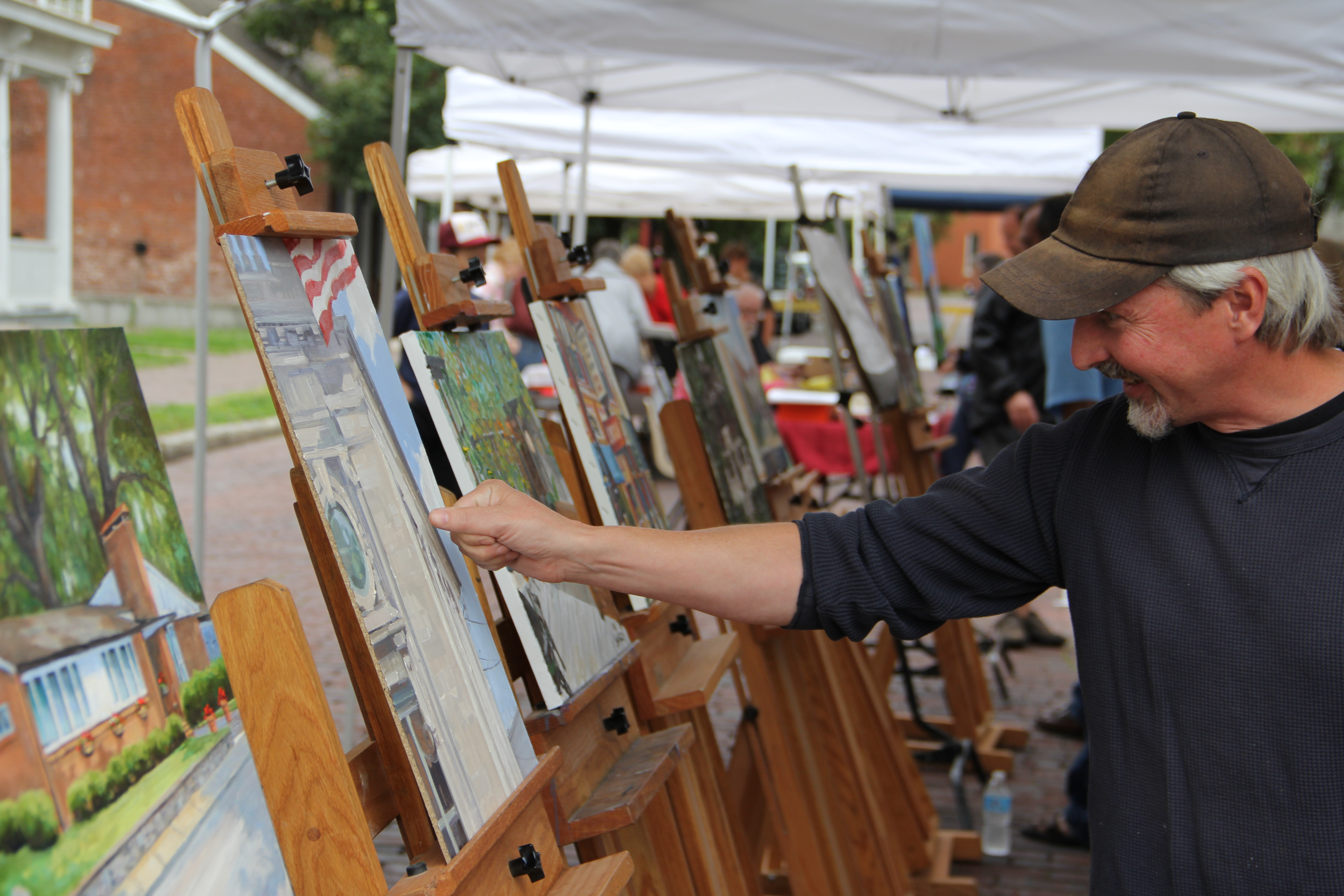 plein air artist shawn cornell reviews his painting of the district 118 offices former artist office