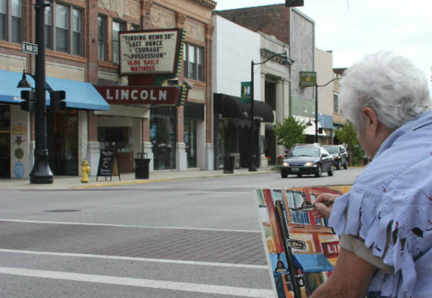 Artist Marilynne Bradley paints the Lincoln Theatre at the 2012 Plein Air Art Auction.