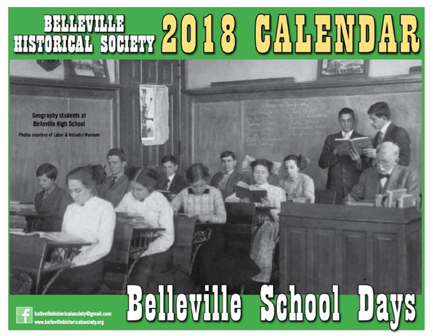 Cover of 2018 calendar showing black-and-white photo of students in a schoolhouse